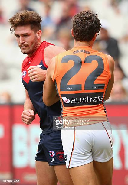 Tomas Bugg of the Demons bumps Josh Kelly of the Giants during the round one AFL match between the Melbourne Demons and the Greater Western Sydney...