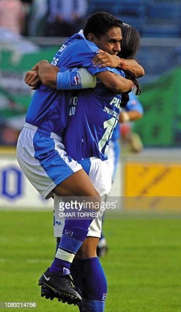 Tomas Campos of the Cruz Azul hugs his teammate Francisco Palencia during a match against the Santos 07 April 2001 in Mexico City Mexico Tomas Campos...