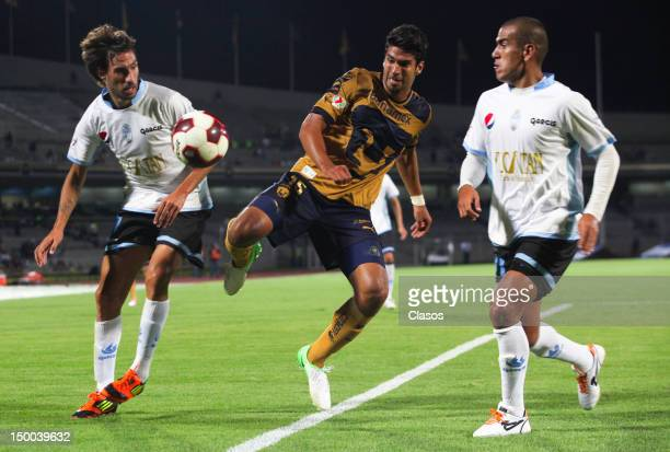 Tomas Charles of Merida fights for the ball with Eduardo Herrera of Pumas during a match between Pumas and Merida as part of the Copa MX 2012 at...