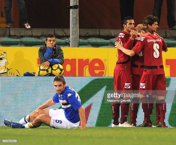 Tomas Danilevicius of AS Livorno celebrates after scoring his team's first goal with team mates during the TIM Cup match between UC Sampdoria and AS...