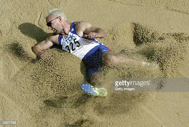 Tomas Dvorak of Czech Republic lands in the pit during the long jump in the men's decathlon during the 9th World Athletics Championships at the Stade...