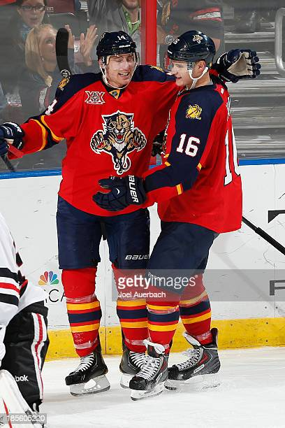 Tomas Fleischmann is congratulated by Aleksander Barkov of the Florida Panthers after scoring a third period goal against the Chicago Blackhawks at...