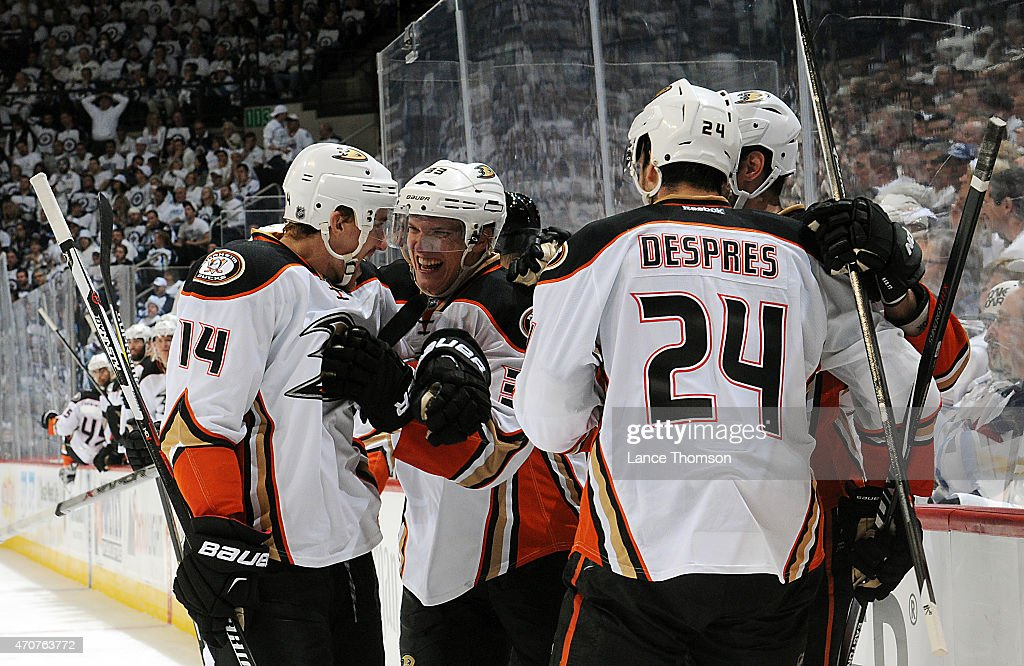 Tomas Fleischmann #14, Jakob Silfverberg #33, Simon Depres #24 and Ryan Kesler #17 of the Anaheim Ducks celebrate a third period goal against the Winnipeg Jets in Game Four of the Western Conference Quarterfinals during the 2015 NHL Stanley Cup Playoffs on April 22, 2015 at the MTS Centre in Winnipeg, Manitoba, Canada.