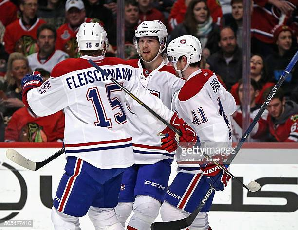 Tomas Fleischmann, Lars Eller and Paul Byron of the Montreal Canadiens celebrate Eller's first period goal against the Chicago Blackhawks at the...