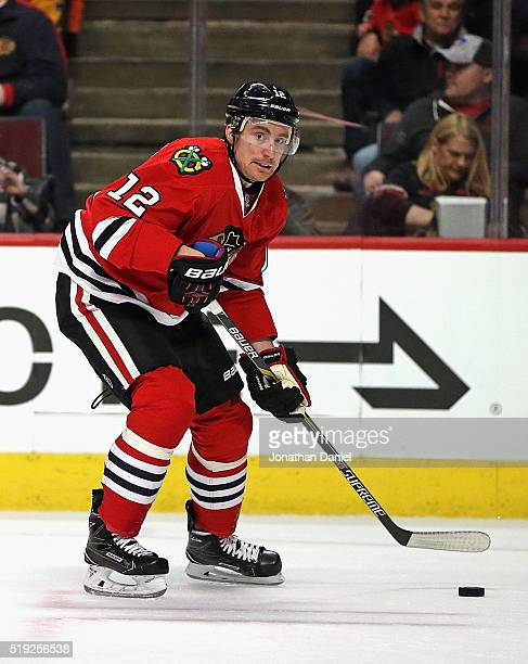 Tomas Fleischmann of the Chicago Blackhawks controls the puck against the Boston Bruins at the United Center on April 3 2016 in Chicago Illinois The...