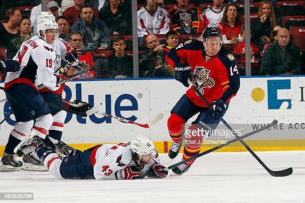 Tomas Fleischmann of the Florida Panthers tangles with Tom Wilson of the Washington Capitals at the BBT Center on December 16 2014 in Sunrise Florida