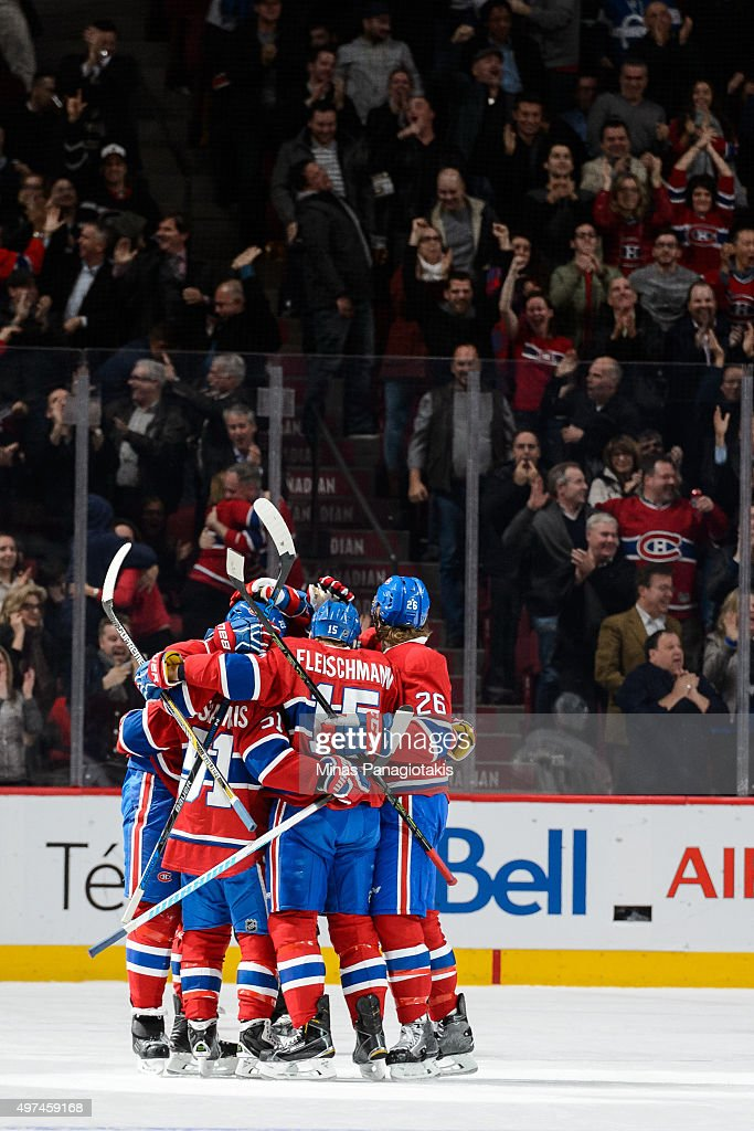Tomas Fleischmann #15 of the Montreal Canadiens celebrates his goal with teammates after tying the game in the third period during the NHL match against the Vancouver Canucks at the Bell Centre on November 16, 2015 in Montreal, Quebec, Canada. The Montreal Canadiens defeated the Vancouver Canucks 4-3 in overtime.