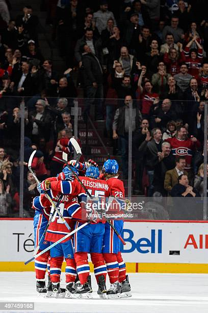 Tomas Fleischmann of the Montreal Canadiens celebrates his goal with teammates after tying the game in the third period during the NHL match against...