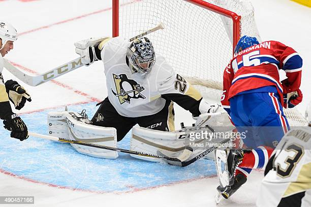 Tomas Fleischmann of the Montreal Canadiens gets a shot on goaltender MarcAndre Fleury of the Pittsburgh Penguins during the NHL preseason game at...