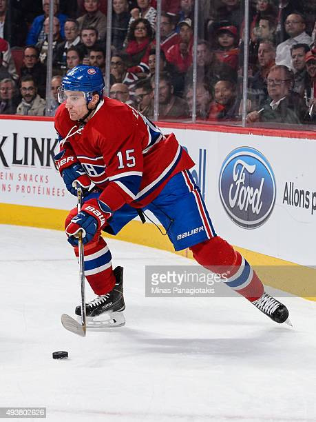 Tomas Fleischmann of the Montreal Canadiens looks to play the puck during the NHL game against the St Louis Blues at the Bell Centre on October 20...