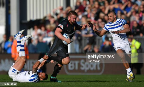 Tomas Francis of Exeter Chiefs is tackled by Kahn Fotuali'i of Bath during the Gallagher Premiership Rugby match between Exeter Chiefs and Bath Rugby...