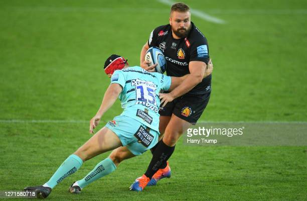 Tomas Francis of Exeter Chiefs is tackled by Tom Hudson of Gloucester Rugby during the Gallagher Premiership Rugby match between Exeter Chiefs and...