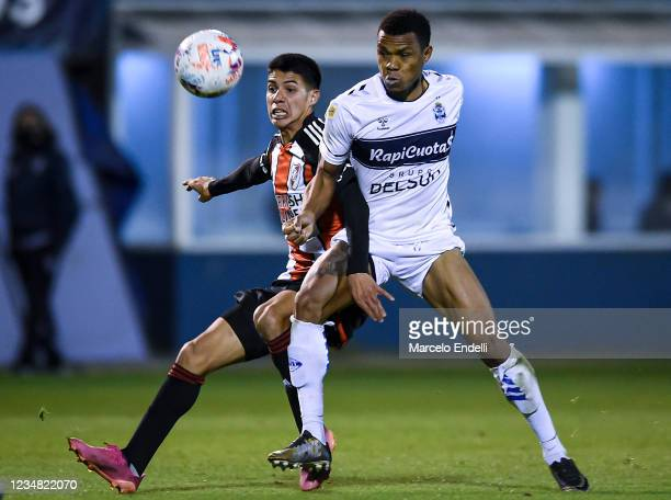 Tomas Galvan of River Plate fights for the ball with Harrinson Mansilla of Gimnasia La Plata during a match between Gimnasia Esgrima La Plata and...