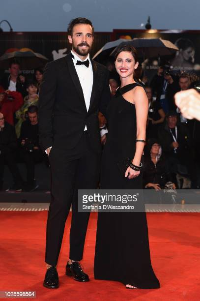 Tomas Goldschmidt and Lodovica Comello walk the red carpet ahead of the 'A Star Is Born' screening during the 75th Venice Film Festival at Sala...