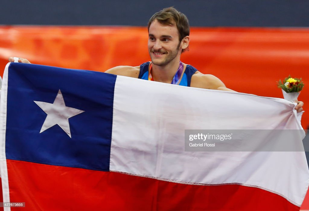 Tomas Gonzalez of Chile holds his national flag in the podium Men's Floor Event during day four of the X South American Games Santiago 2014 at Centro de Alto Rendimiento Mahuida on March 10, 2014 in Santiago, Chile.
