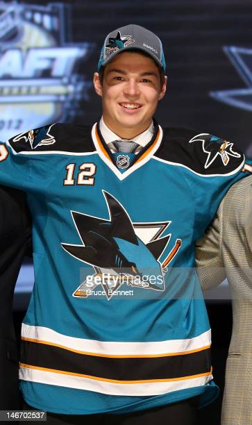 Tomas Hertl, 17th overall pick by the San Jose Sharks, poses on stage during Round One of the 2012 NHL Entry Draft at Consol Energy Center on June...