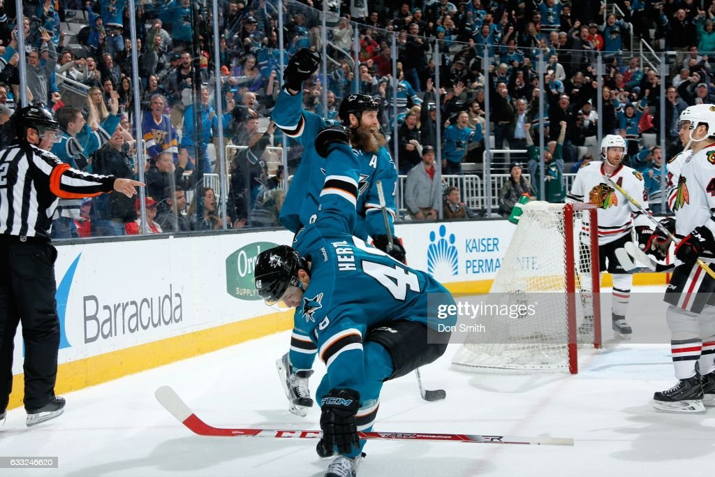 Tomas Hertl #48 and Joe Thornton #19 of the San Jose Sharks celebrate Hertl's third period goal during a NHL game against the Chicago Blackhawks at SAP Center at San Jose on January 31, 2017 in San Jose, California.