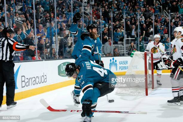 Tomas Hertl and Joe Thornton of the San Jose Sharks celebrate Hertl's third period goal during a NHL game against the Chicago Blackhawks at SAP...