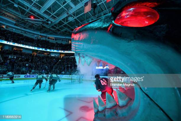 Tomas Hertl. Brent Burns and Logan Couture of the San Jose Sharks takes the ice through the Shark Head against the Edmonton Oilers at SAP Center on...