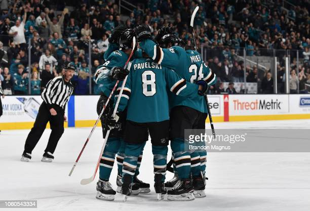 Tomas Hertl Joe Pavelski and Timo Meier of the San Jose Sharks celebrate a goal against the Calgary Flames at SAP Center on November 11 2018 in San...