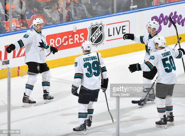 Tomas Hertl Logan Couture MarcEdouard Vlasic and Chris Tierney of the San Jose Sharks celebrate after winning the game against the Edmonton Oilers on...