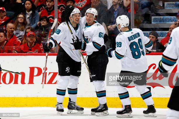 Tomas Hertl Mikkel Boedker and teammates of the San Jose Sharks celebrate a goal against the Calgary Flames during an NHL game on March 16 2018 at...