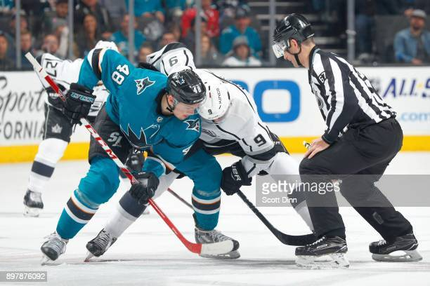 Tomas Hertl of the San Jose Sharks and Adrian Kempe of the Los Angeles Kings faceoff at SAP Center on December 23 2017 in San Jose California