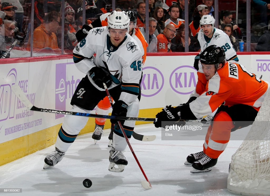 Tomas Hertl #48 of the San Jose Sharks and Ivan Provorov #9 of the Philadelphia Flyers fight for the puck on November 28, 2017 at Wells Fargo Center in Philadelphia, Pennsylvania.