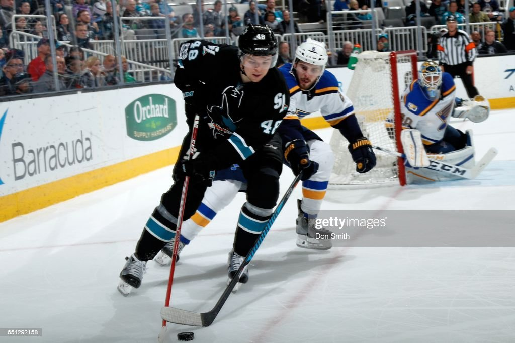 Tomas Hertl #48 of the San Jose Sharks and Joel Edmundson #6 of the St. Louis Blues battle for the puck at SAP Center at San Jose on March 16, 2017 in San Jose, California.