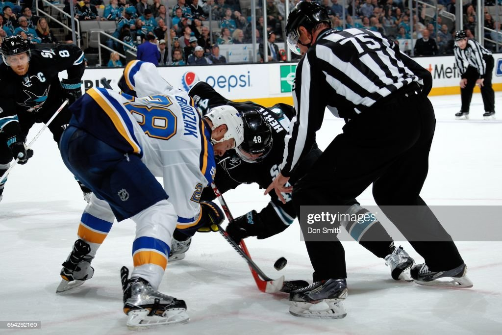 Tomas Hertl #48 of the San Jose Sharks and Kyle Brodziak #28 of the St. Louis Blues face off at SAP Center at San Jose on March 16, 2017 in San Jose, California.