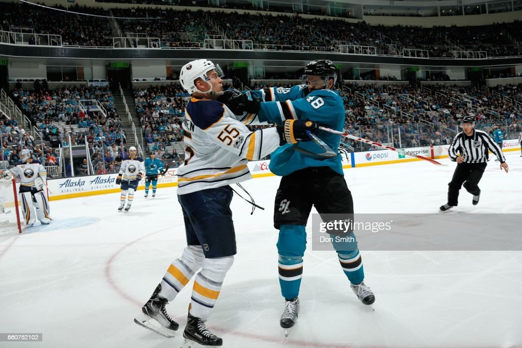 Tomas Hertl #48 of the San Jose Sharks and Rasmus Ristolainen #55 of the Buffalo Sabres get into a shoving match during a NHL game at SAP Center at San Jose on October 12, 2017 in San Jose, California.