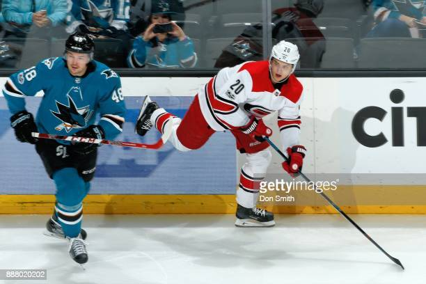 Tomas Hertl of the San Jose Sharks and Sebastian Aho of the Carolina Hurricanes skate at SAP Center on December 7 2017 in San Jose California