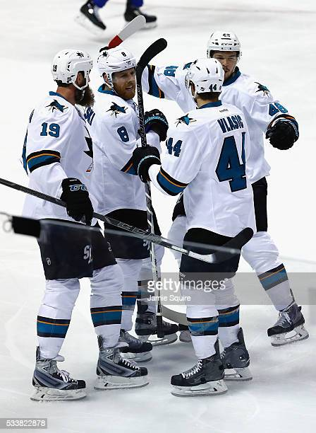 Tomas Hertl of the San Jose Sharks celebrates with Joe Thornton Joe Pavelski and MarcEdouard Vlasic after scoring a first period goal against the St...