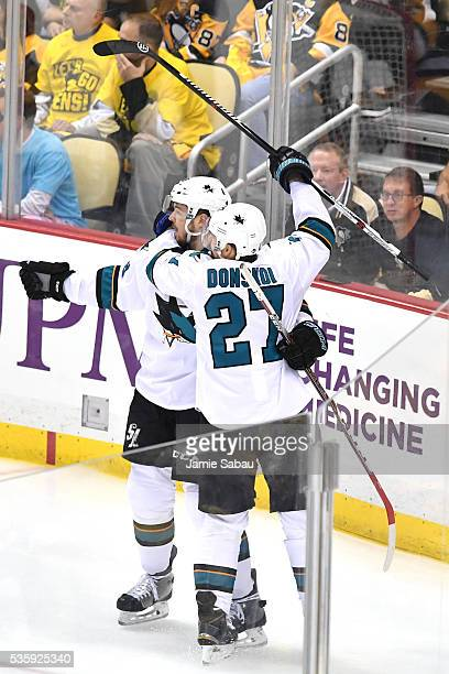 Tomas Hertl of the San Jose Sharks celebrates with Joonas Donskoi after scoring a second period goal against Matt Murray of the Pittsburgh Penguins...