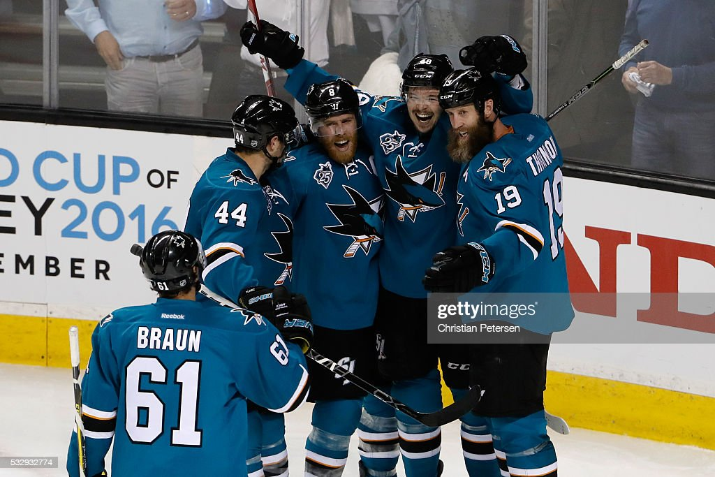 Tomas Hertl #48 of the San Jose Sharks celebrates with Justin Braun #61, Marc-Edouard Vlasic #44, Joe Pavelski #8 and Joe Thornton #19 after his second goal in game three of the Western Conference Finals against the St. Louis Blues during the 2016 NHL Stanley Cup Playoffs at SAP Center on May 19, 2016 in San Jose, California.
