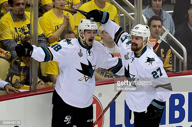Tomas Hertl of the San Jose Sharks celebrates with teammates after scoring a second period goal against Matt Murray of the Pittsburgh Penguins in...