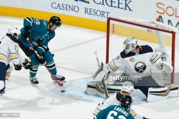 Tomas Hertl of the San Jose Sharks gets one by Robin Lehner of the Buffalo Sabres to score in the first period during a NHL game at SAP Center at San...