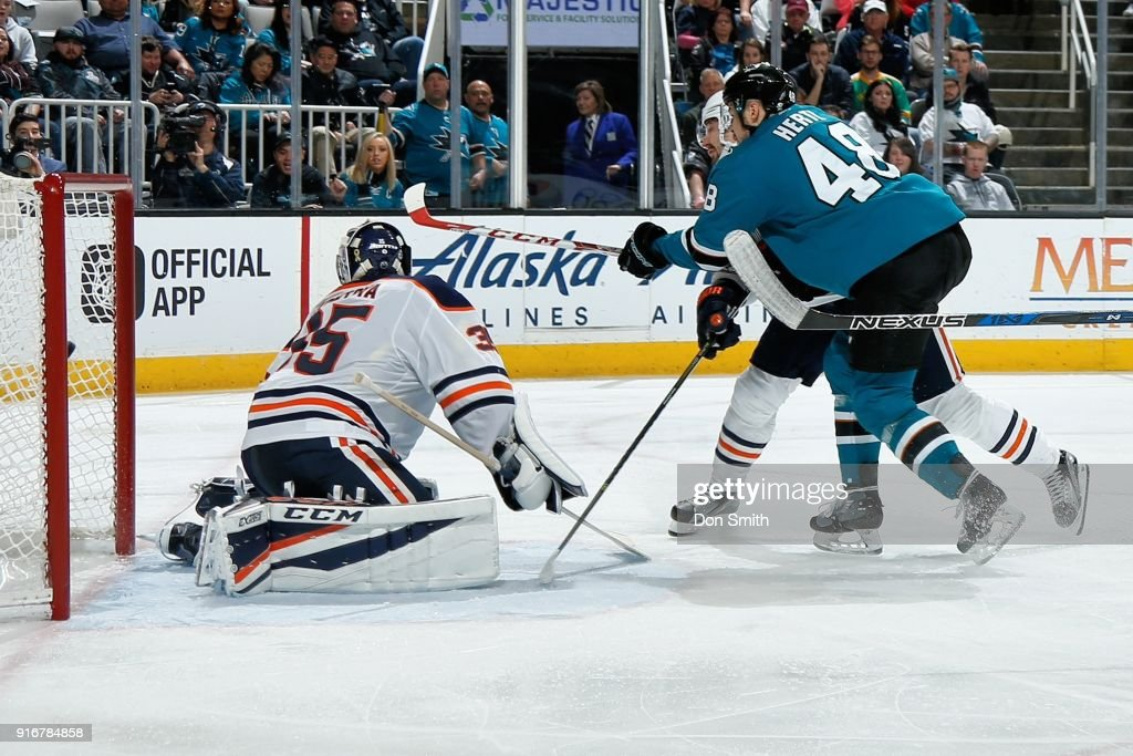 Tomas Hertl #48 of the San Jose Sharks gets the puck by Al Montoya #35 of the Edmonton Oilers to score a goal in the third period at SAP Center on February 10, 2018 in San Jose, California.