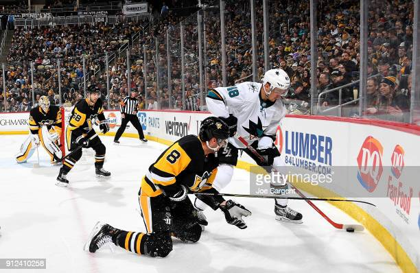 Tomas Hertl of the San Jose Sharks handles the puck against Brian Dumoulin of the Pittsburgh Penguins at PPG Paints Arena on January 30 2018 in...