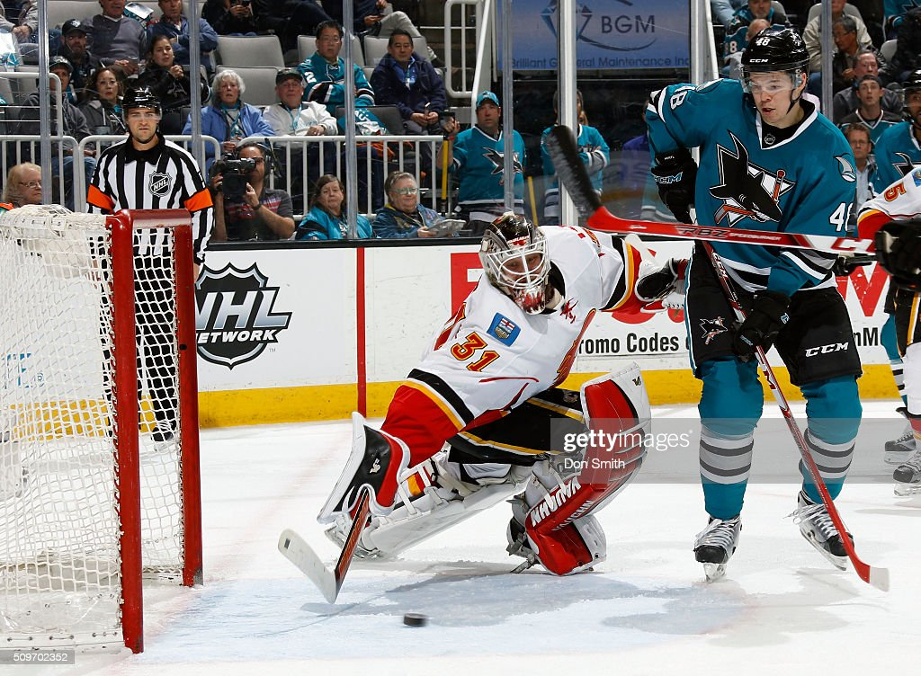 Tomas Hertl #48 of the San Jose Sharks has his shot blocked against Karri Ramo #31 of the Calgary Flames during a NHL game at the SAP Center at San Jose on February 11, 2016 in San Jose, California.