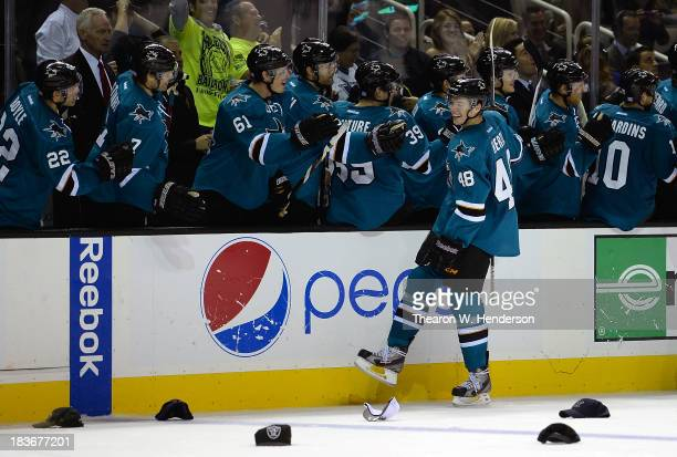 Tomas Hertl of the San Jose Sharks is congratulated by teammates after he scored his third goal of the game against the New York Rangers during the...