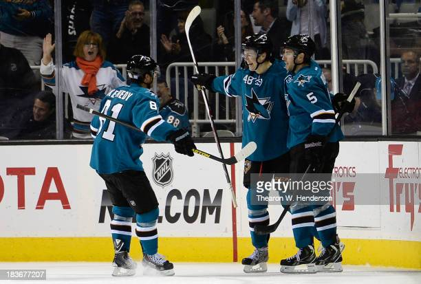 Tomas Hertl of the San Jose Sharks is congratulated by Tyler Kennedy and Jason Demers after he scored his fourth goal of the game against the New...