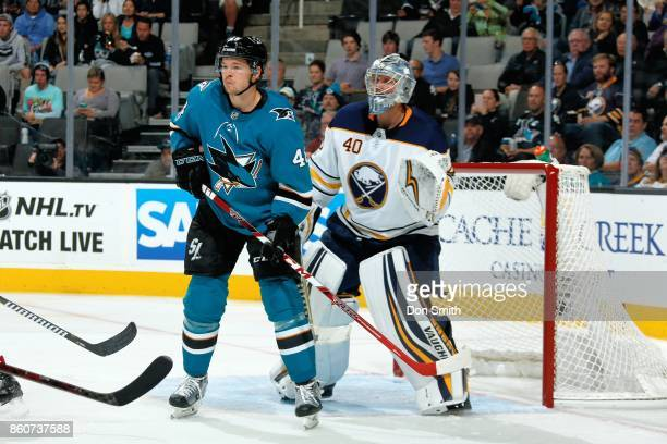 Tomas Hertl of the San Jose Sharks is defended by Robin Lehner of the Buffalo Sabres during a NHL game at SAP Center at San Jose on October 12 2017...