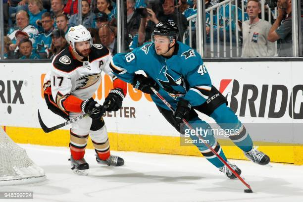 Tomas Hertl of the San Jose Sharks keeps the puck away from Ryan Kesler of the Anaheim Ducks in Game Four of the Western Conference First Round...