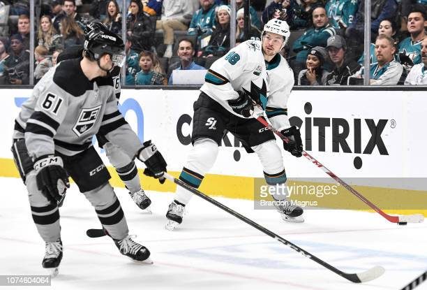 Tomas Hertl of the San Jose Sharks keeps the puck away from Sean Walker of the Los Angeles Kings at SAP Center on December 22 2018 in San Jose,...
