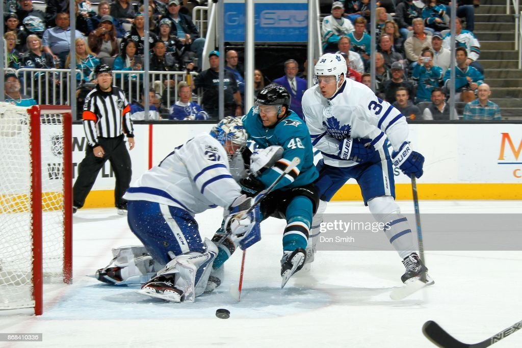 Tomas Hertl #48 of the San Jose Sharks runs into Frederik Andersen #31 of the Toronto Maple Leafs as Auston Matthews #34 of the Toronto Maple Leafs defends at SAP Center on October 30, 2017 in San Jose, California.