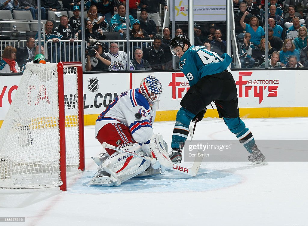 Tomas Hertl #48 of the San Jose Sharks scores a goal against Martin Biron #43 of the New York Rangers during an NHL game on October 8, 2013 at SAP Center in San Jose, California.