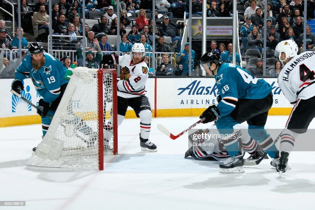 Tomas Hertl #48 of the San Jose Sharks scores a third period goal while Joe Thornton #19 of the San Jose Sharks, Duncan Keith #2 and Niklas Hjalmarsson #4 of the Chicago Blackhawks look during a NHL game at SAP Center at San Jose on January 31, 2017 in San Jose, California.