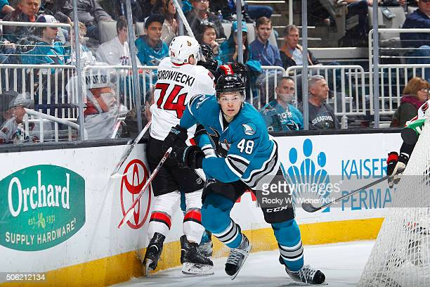Tomas Hertl of the San Jose Sharks skates against Mark Borowiecki of the Ottawa Senators at SAP Center on January 18 2016 in San Jose California