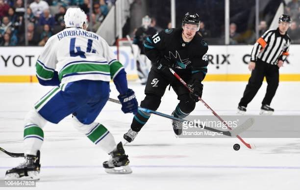 Tomas Hertl of the San Jose Sharks skates the puck ahead against the Vancouver Canucks at SAP Center on November 23, 2018 in San Jose, California